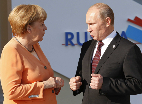 Merkel in rare Russia visit as Putin backs warmer ties