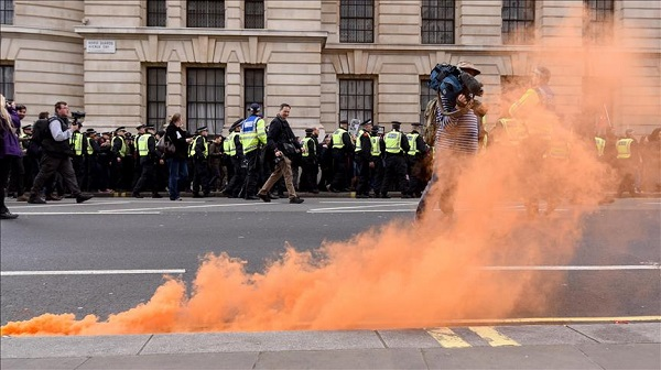 Police arrest 5 in London anti-immigration protest