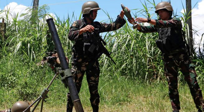 Philippine air strikes target high-rise snipers
