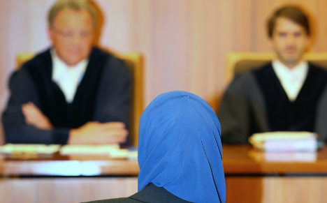 German judge bans woman from wearing headscarf in court