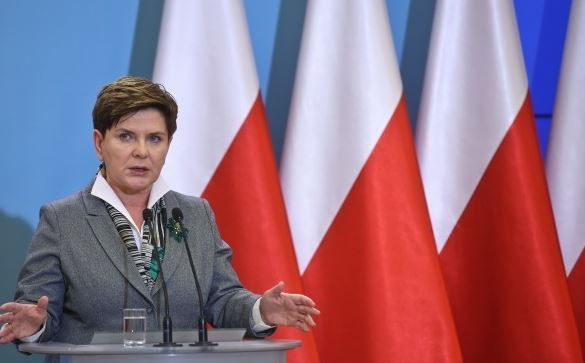 Polish PM downsizes govt after uproar over pay bonuses