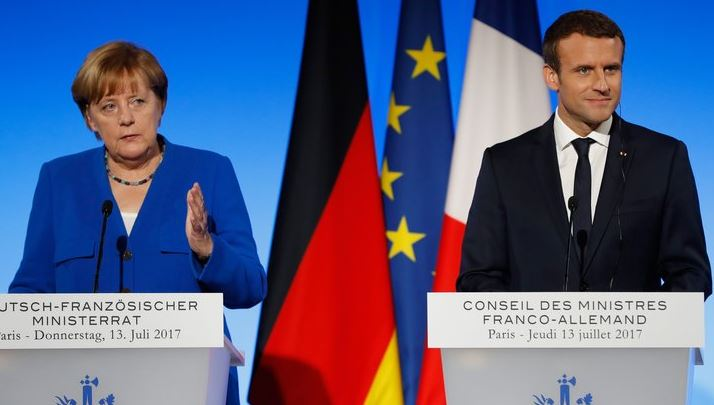 Hosting Merkel, Macron gets chance to push EU business