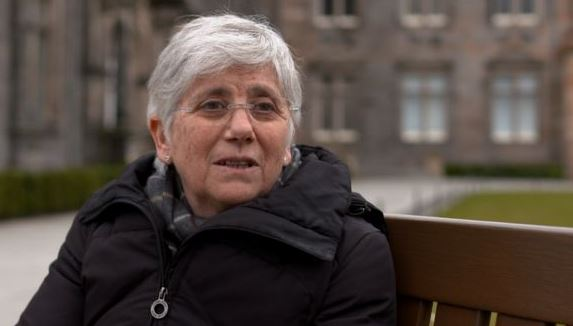 Former Catalan minister hands herself in