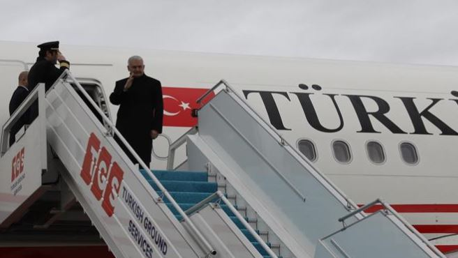 Turkish premier leaves for Spain