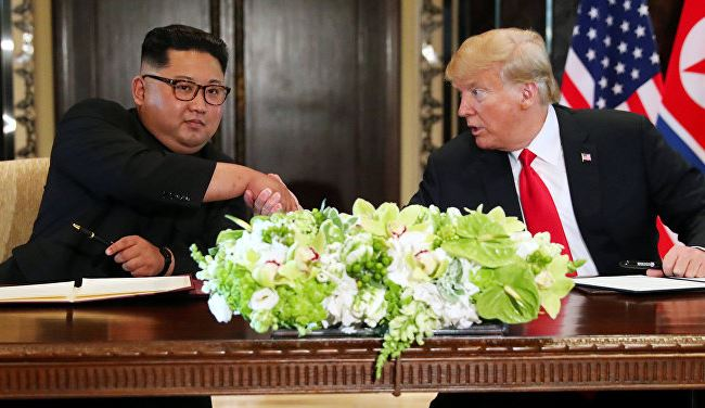 Trump and Kim open historic summit with handshake