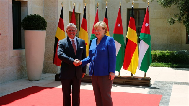 Germany's Merkel meets Jordanian king in Amman