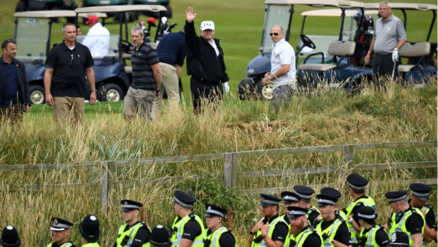 Protests continue as Trump arrives in Scotland