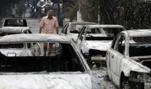 Greek PM Tsipras visits scene of wildfire disaster