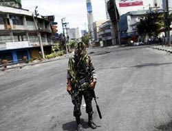 Thai military lifts curfew in some tourist areas, not Bangkok