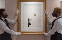 Banksy's half-shredded painting sold for record...