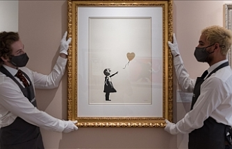 Banksy's half-shredded painting sold for record $25.4M