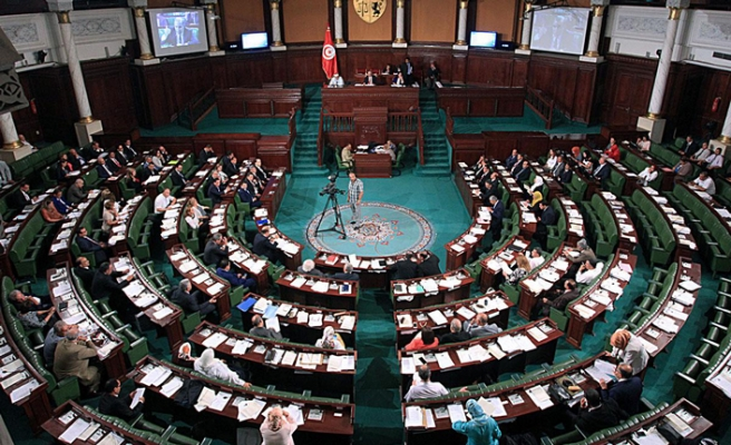 Tunisia party tells cabinet members to leave government