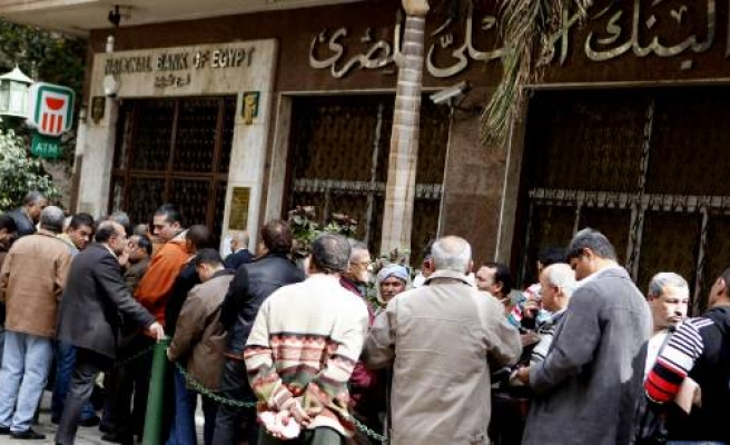 Egypt's Banks open for first time after protests