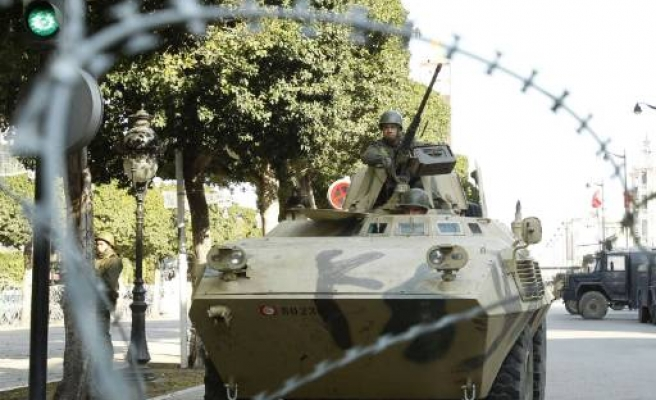 Tunisia says it seizes armed group linked to ex-leader