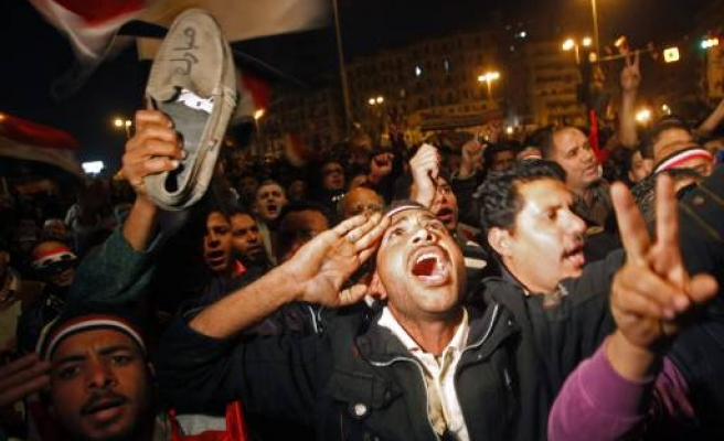 Angry protesters wave shoes at Mubarak speech