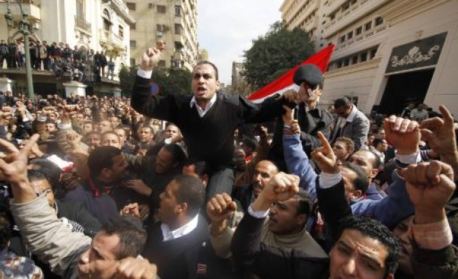 Egypt police march in Tahrir