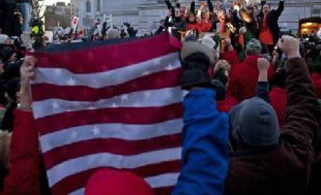 Wisconsin persists on cuts, protests swell