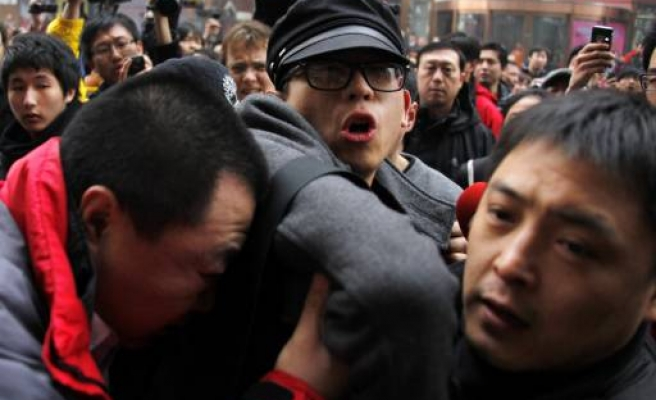 China blocks planned Arab-inspired protests