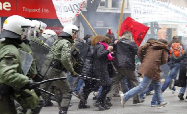 Greek police fire teargas at anti-austerity protesters