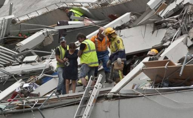 New Zealand rescuers pull survivors out of rubble