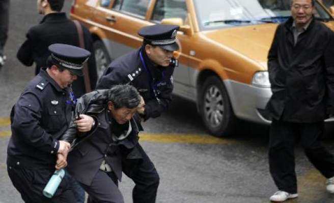 China protest call smothered in police blanket
