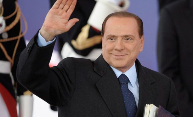 Court lifts ban on Berlusconi running for public office
