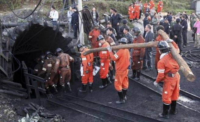 China suspends 8 officials for mine accident