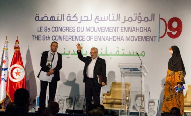 Tunisia ruling party re-elects Ghannouchi as leader