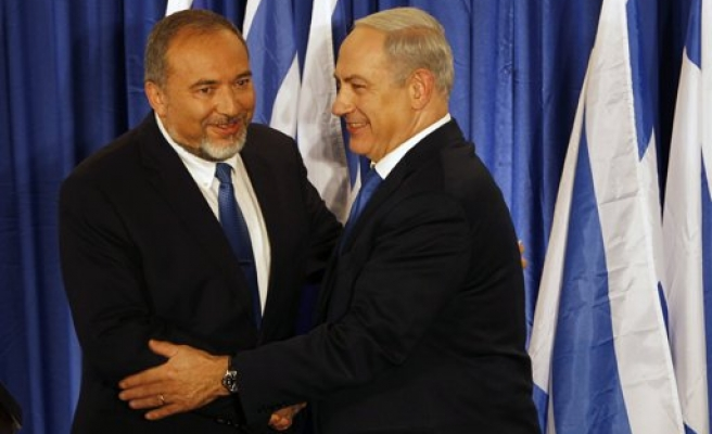 Israel's Netanyahu, Lieberman form far-right alliance for ballot
