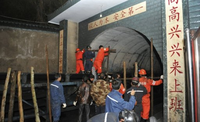 China suspends eight officials over coal mine accident