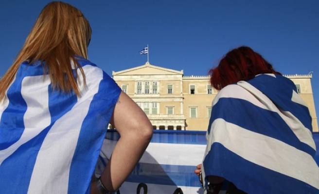 EU, IMF agree to lend Greece 49 bln euros by March