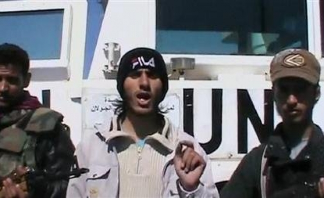 U.N. Golan peacekeepers pull back from Syrian positions