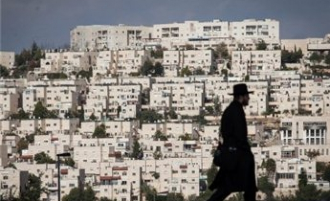 Israel says it doubled new settlement building in 2013