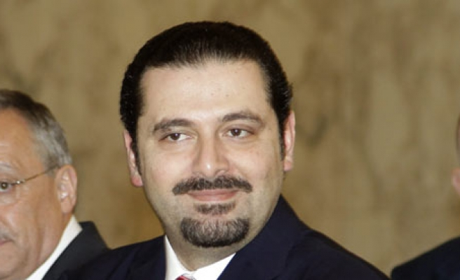 Hariri says Hezbollah must withdraw from Syria