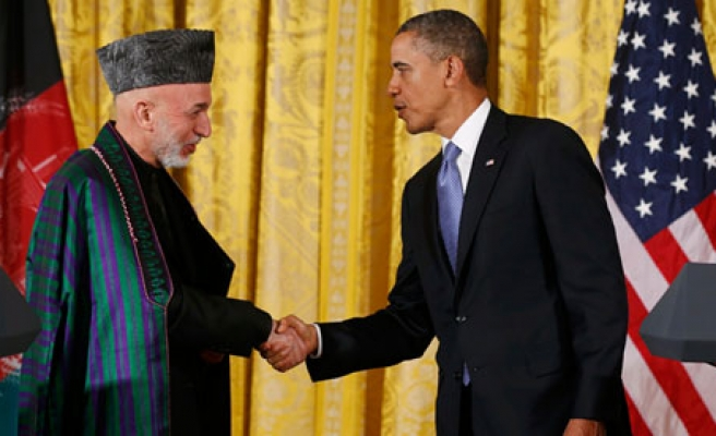 US spy chief  does not believe Karzai will sign security pact