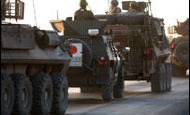 Japan troops withdraw from Iraq
