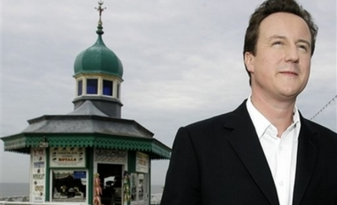 UK's PM Cameron says to form coalition government
