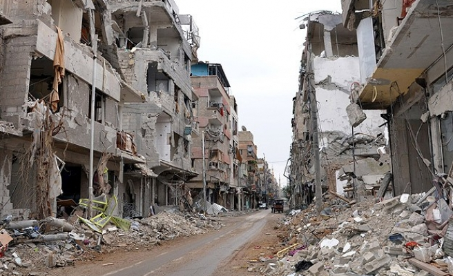 Syrian regime questions over 300 men from Homs