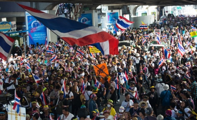 Thai protest leader says to unblock roads but target ministries