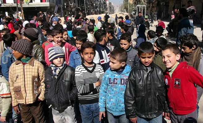 Children play in the streets of Yarmouk as ceasefire starts