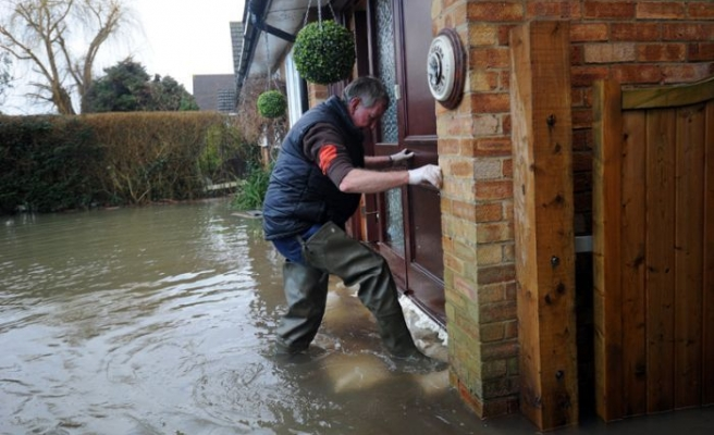 Two dead as storms batter Britain