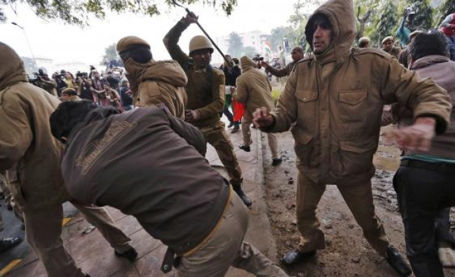 Street clashes break out as India announces elections