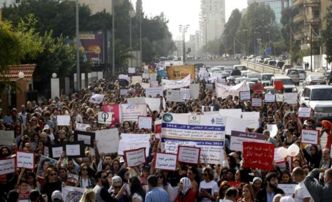 Lebanese protest domestic abuse on Women's Day