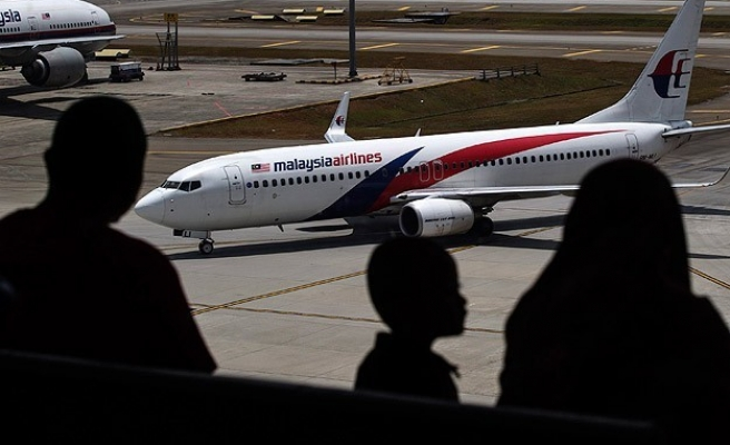 Malaysia Airlines plane returns safely after landing gear scare