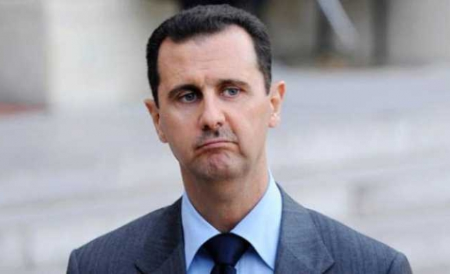 U.S. says Assad must go, but expects he will stay