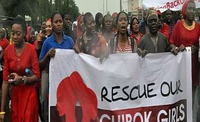 Nigeria arrests protest leader for girls, Boko Haram claims abduction
