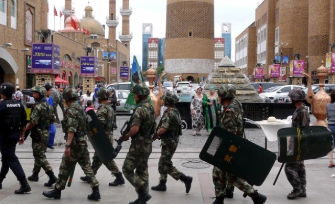 China sentences three Uighurs to death for Beijing attack