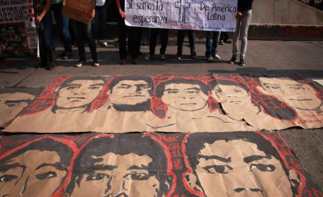 Protesters over missing students in Mexico burn state assembly