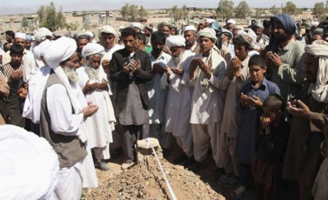 Dozens killed in Afghanistan in attacks on funeral