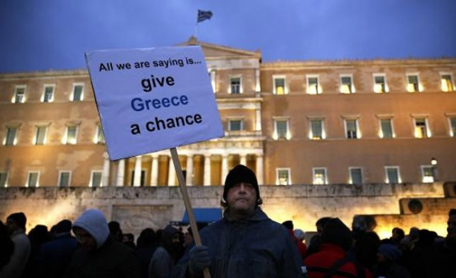 Greece, euro zone creditors reach accord on loan